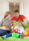 Parents and child plays with toys — Stock Photo