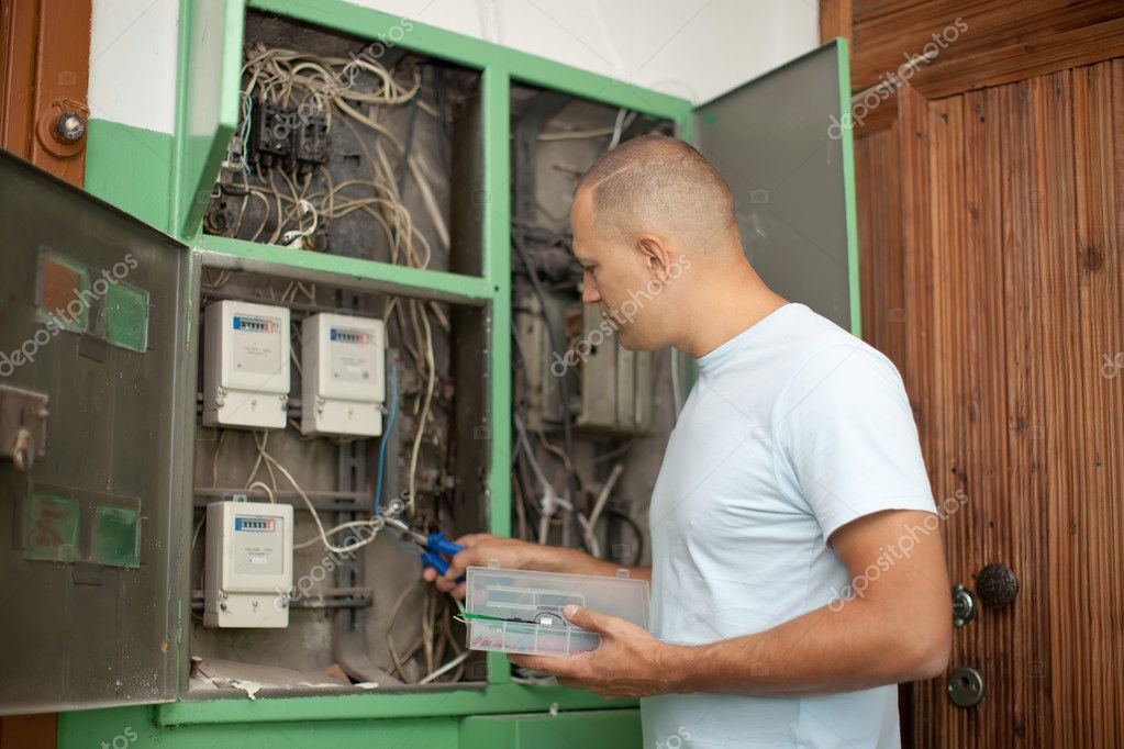 Electrician working with electric box at house — Stock Photo #13665750