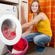 Woman loading the washing machine — Stock Photo
