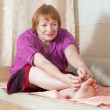 Stock Photo: Woman treats her toenails