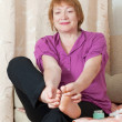 Woman treats her toenails — Stock Photo