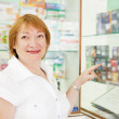 Woman chooses contraceptives at pharmacy — Stock Photo