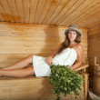 Girl is steamed in the sauna — Stock Photo