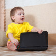 Toddler sits with laptop — Stock Photo #13676132