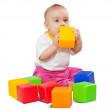 Royalty-Free Stock Photo: Baby plays  with toy blocks over white