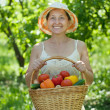 Royalty-Free Stock Photo: Happy woman with vegetables harvest