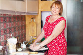 Mature woman makes pie with fillings — Stock Photo