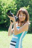 Female photographer with camera — Stock Photo