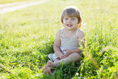 2 years girl in summer meadow — Stock Photo