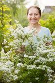 Happy mature gardener at garden — Stock Photo