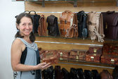 Woman chooses leather chest — Stock Photo