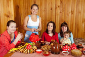 Family drinking tea with russian snack — Stock Photo