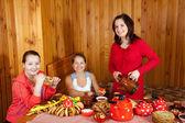 Women eating pancake during Maslenitsa festival — Stock Photo