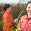 Stock Photo: Women pruned branches in garden