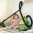 Baby girl with vacuum cleaner — Stock Photo #15259983