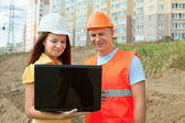 Architects works in front of building site — Stock Photo