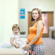 Pregnant womwith child waits to attendance of doctor — Stock Photo #15260255