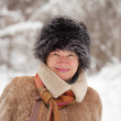 Mature woman in wintry forest — Stock Photo
