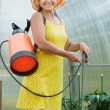 Gardener working with knapsack spray — Stock Photo #15260513