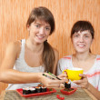 women eating sushi rolls — Stock Photo