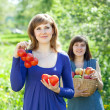 Happy girls with harvest — Stock Photo