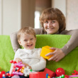 Happy mother plays with child — Stock Photo