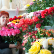 Stock Photo: Florist in her small flower shop