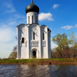 Church of  Intercession on River Nerl in flood - Stock Photo