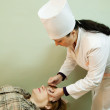 Stock Photo: Ophthalmologist measures eye pressure