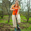 Mature woman making orchard - Stock fotografie