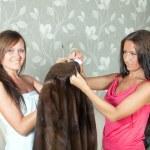Women cleaning fur coat — Stock Photo #15261755