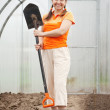Stock Photo: Happy mature womin hothouse
