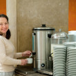 Woman pours  coffee  — Stock Photo