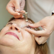 Ophthalmologist measures the  ocular tension - 