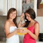 Two women testing soup — Stock Photo #15262299