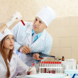 Stock Photo: Male doctor and nurse in medical laboratory