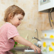 Baby girl washing dishes — Stock Photo #15262639