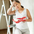 Wommakes repairs at home — Stock Photo #15262649