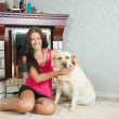 Stock Photo: Woman with Labrador in home