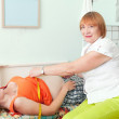 Doctor measuring waist of pregnant woman — Stock Photo #15262759