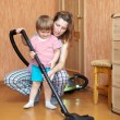 Stok fotoğraf: Mother and daughter chores with vacuum cleaner
