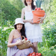 Happy women with vegetables — Stock Photo