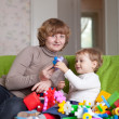 Mother plays with child in home — Stock Photo