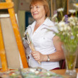 Female artist painting a picture — Stock Photo #15262867