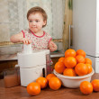 Baby girl making fresh orange juice — Stock Photo #15262895