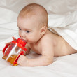 Little girl with baby bottle — Stock Photo