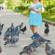 Two-year girl with doves — Stock Photo #15263091