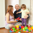 Stock Photo: Family of three in home