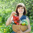 Royalty-Free Stock Photo: Happy  woman with basket of harvested vegetables
