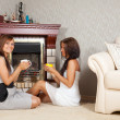 Stock Photo: Women near fireplace